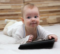 Baby with new tablet pc is thinking what to write to his online friend using his computer Stock Photography