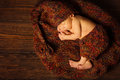 Baby newborn portrait kid sleeping in woolen hat on brown wooden background Stock Photography