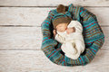 Baby newborn sleeping in woolen hat on white wood wooden background warm winter country style Royalty Free Stock Image