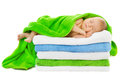 Baby newborn sleeping wrapped in bath towels over white background Royalty Free Stock Photo