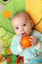 Baby with orange Royalty Free Stock Image