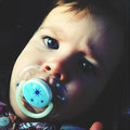 Baby with pacifier girl closeup portrait Royalty Free Stock Photos