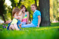 Baby with parents in a beautiful summer park Stock Photo