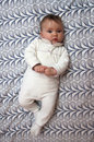 Baby on pattern background Royalty Free Stock Photography