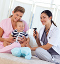 Baby with pediatrician and nurse Royalty Free Stock Photo
