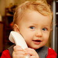 Baby at the phone Stock Photos