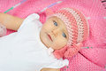 A baby in a pink knitted hat Royalty Free Stock Photo