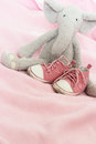 Baby pink shoes and plush elephant Royalty Free Stock Photo
