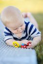 Baby play with bright toy outdoors portrait of six month old Royalty Free Stock Images