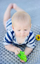 Baby play with bright toy outdoors portrait of six month old Royalty Free Stock Photo