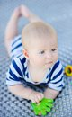 Baby play with bright toy six month old Royalty Free Stock Image