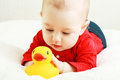Baby play with toy in red cloth smiling Royalty Free Stock Photo