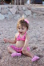 Baby playing on the beach Stock Photo
