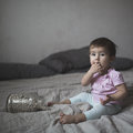 Baby playing on bed of beans, early development, natural toys, Royalty Free Stock Photo