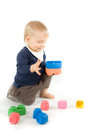 Baby playing with blocks on white background Stock Photo