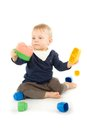 Baby playing with blocks on white background Royalty Free Stock Image