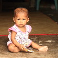 Baby playing with a box little indonesian girl Royalty Free Stock Photography