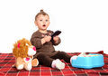 Baby playing with cell phone. Royalty Free Stock Photo