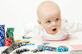 Baby playing with chips beautiful half year old Royalty Free Stock Images
