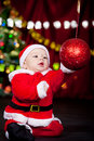 Baby playing with Christmas ball Stock Photography