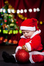 Baby playing with Christmas ball Royalty Free Stock Photos