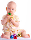 Baby playing with christmas decoration color balls Royalty Free Stock Photo
