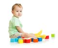 Baby playing with colorful blocks isolated Royalty Free Stock Photo