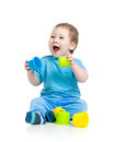 Baby playing with colourful cup toys on floor Stock Photos