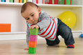 Baby playing with cubes in children s room Royalty Free Stock Photo