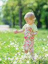 Baby playing with dandelions in park Royalty Free Stock Photo