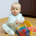 Baby playing on the floor Royalty Free Stock Image