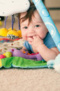 Baby playing on a jungle mat month old Stock Photos