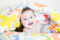 Baby playing peek a boo under colorful blanket funny Royalty Free Stock Photography