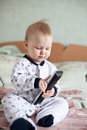 Baby playing with Remote Control Royalty Free Stock Photos