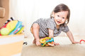 Baby playing on rug and crawling around making faces a the floor Stock Image