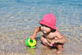 Baby playing sea water Royalty Free Stock Images