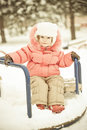 Baby playing on snow in winter Stock Photo