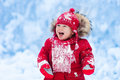 Baby playing with snow in winter. Royalty Free Stock Photo