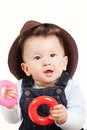 Baby playing with toys hat Stock Image
