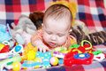 Baby playing toys months Royalty Free Stock Photo