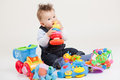 Baby playing with toys white background Stock Photos