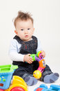Baby playing with toys white background Stock Photography