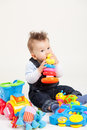 Baby playing with toys white background Stock Images
