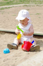 Baby plays in sandpit age of months Royalty Free Stock Image