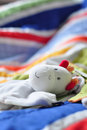 Baby plush on colorful cover Royalty Free Stock Images