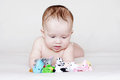Baby with plush toys months Stock Images