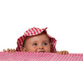 Baby portrait with hat and checkered tablecloth Stock Photos