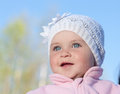 Baby portrait in a white cap against the sky Stock Photo