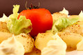 Baby potatoes and tomato closeup white plate with roasted lettuce with mayonnaise dressing close up Stock Photos