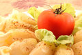 Baby potatoes with tomato white plate roasted lettuce and mayonnaise dressing close up Stock Images